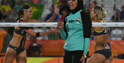 Egypt s Doaa Elghobashy  C  reacts as Germany s Kira Walkenhorst  L  and Germany s Laura Ludwig celebrate winning a point during the women s beach volleyball qualifying match between Germany and Egypt at the Beach Volley Arena in Rio de Janeiro on August 7  2016  for the Rio 2016 Olympic Games    AFP PHOTO   Yasuyoshi Chiba